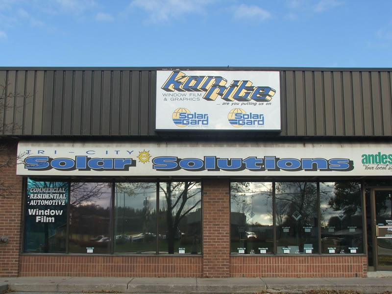 Window lettering in white on our business windows